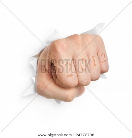 Hand with 2012 tattoo punching through paper isolated on white background poster