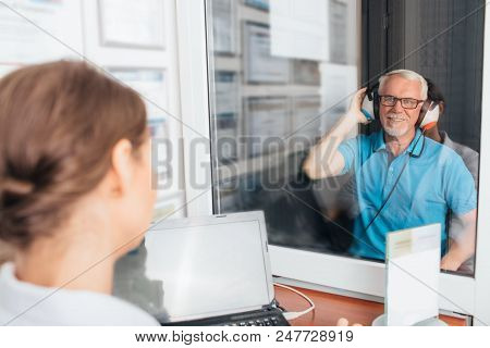 Senior Man Getting A Hearing Test At A Doctors Office, Audiometer Hearing Test