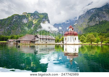 Classic Panoramic View Of Lake Konigssee With World Famous Sankt Bartholomae Pilgrimage Church And W