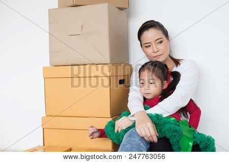Woman Holding Kid With Sad Emotion. People With Unsuccess For Business Concept.