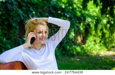Pleasant Conversation. Girl Blonde Smiling Face Talk Smartphone Green Nature Background. Woman Havin