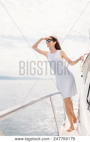 Stylish Graceful Woman With Sun Glasses Looking At Seasides Resting On Luxury Yacht In Summer Day. O