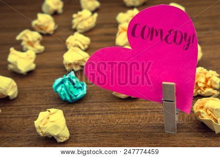 Word writing text Comedy Call. Business concept for Fun Humor Satire Sitcom Hilarity Joking Entertainment Laughing Clothespin holding pink heart paper crumpled papers ideas mistakes trials poster