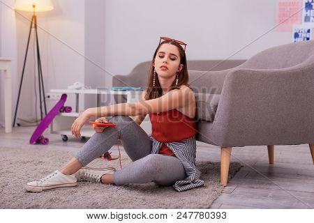 Teen Meloman. Meditative Teen Girl Using Earphones And Closing Eyes