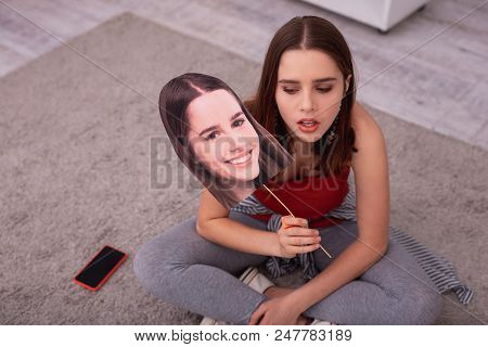 Teen Crises. Top View Of Desperate Teen Girl Carrying Photo And Sitting On Floor