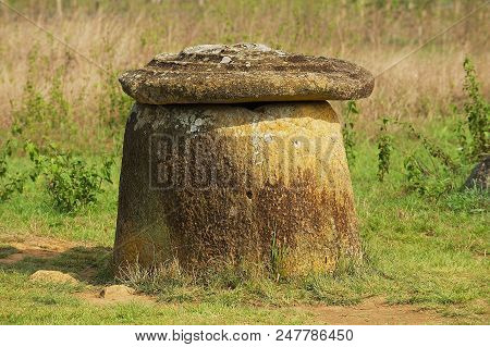 Ancient Stone Jar With Stone Cover In A Plain Of Jars (site #1) Near Phonsavan, Xiangkhouang Provinc