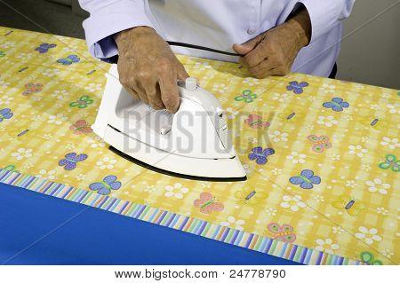 Woman ironing fabric.