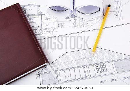 Pencil, Diary, Blueprints On Desktop