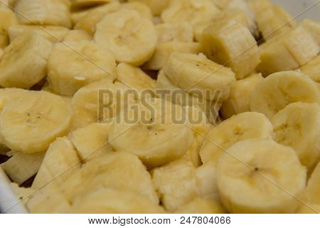 Banana Sliced Into A Pot, Ready To Be Turned Into Sweet