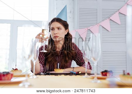 Pessimistic Woman. Woman Wearing Stylish Clothes Feeling Pessimistic At Birthday Party After Breakup