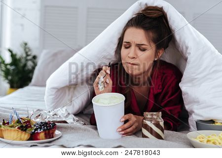 Lots Of Desserts. Heartbroken Woman Eating A Lot Of Desserts Because Of Depression And Huge Stress A