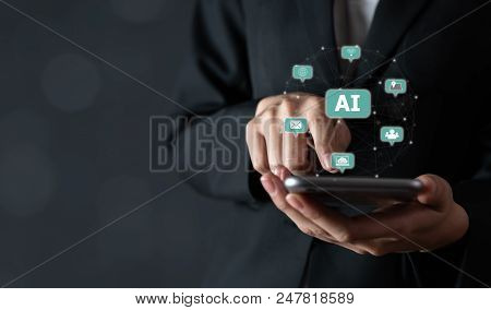 Businessman Holding Smartphone And Touch Sign Text Ai (artificial Intelligence). Future Technology C