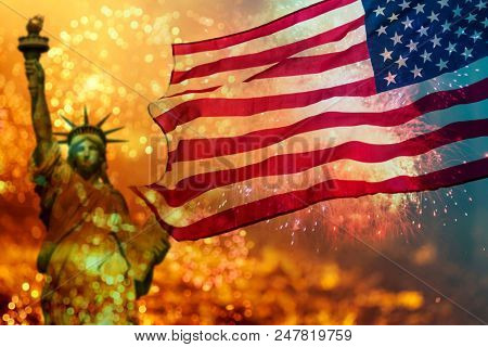 USA flag and the statue of liberty with fireworks background for 4th of July