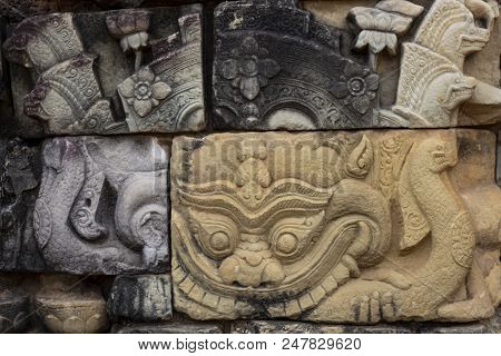 Ancient Temple Stone Carved Bas-relief In Angkor Wat. Barong Daemon Or Dragon Bas-relief Closeup. An