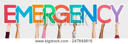 Diverse hands holding the word emergency