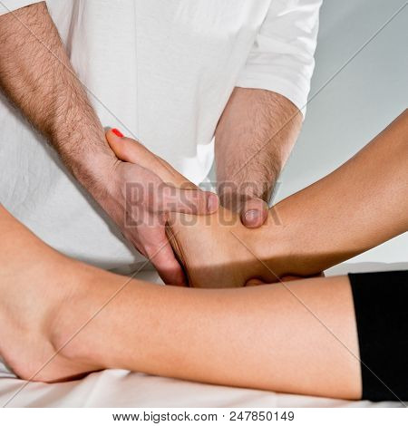Chiropractic treatment of female's feet poster
