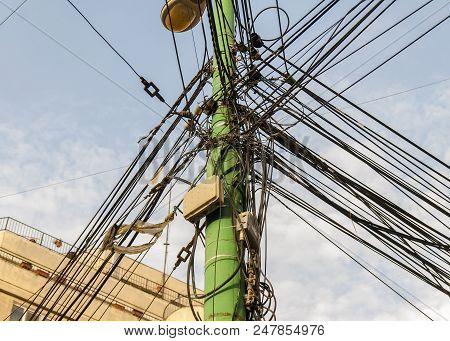 Electricity Pole And Street Light Complicated Wiring On The Pole