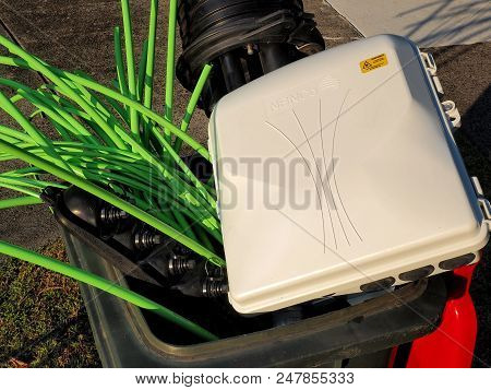 Melbourne, Australia - May 14, 2018: Rubbish Bin Full Of Nbn Fibre Optic Cables And Accessories
