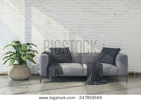 Minimalist converted loft living room interior with cement floor, white brick wall an upholstered grey couch and leafy green houseplant lit by sunlight. 3d render