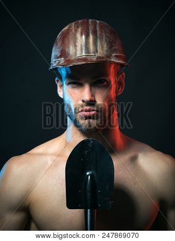 Muscle Sexy Worker In Helmet With Shovel. Muscular Builder, Repairman, Engineer, Constructor, Male W