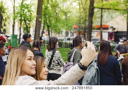 Bishkek, Kyrgyz Republic - April 14, 2018: Selfie Time. Handsome Friends Making Selfie And Smiling W