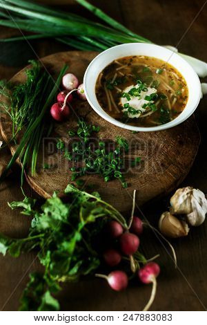 Fresh chicken soup on wooden table