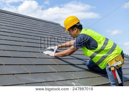 Roof Repair, Worker With White Gloves Replacing Gray Tiles Or Shingles On House With Blue Sky As Bac