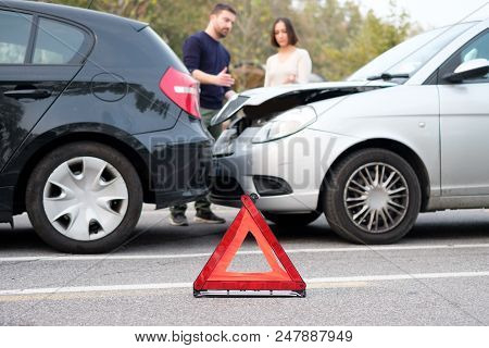 People Discussing After A Car Crash And Trying To Find An Agreement