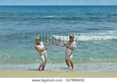 Beautiful Elderly Couple Resting On Tropical Resort