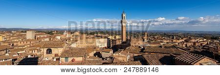 Cityscape Of Siena With The Torre Del Mangia 87 M. (tower Of Mangia) On Blue Sky With Clouds. Toscan