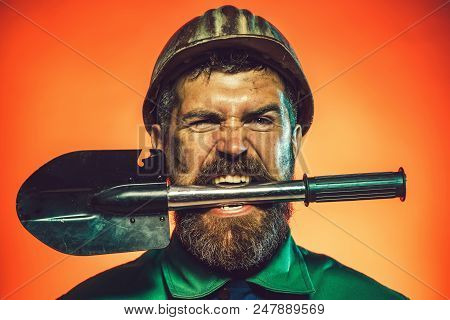 Industrial Worker Protective Helmet With Spade. Builder, Construction Worker With Spade. Man In Hard