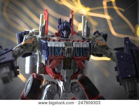 JUNE 30 2018: Recreation of a scene from Transformers the Movie with Autobot leader Optimus Prime ready for battle - Hasbro action figure