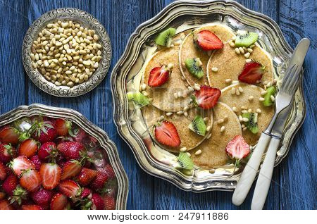Pancakes On Rice Flour With Kiwi Strawberries And Pine Nuts