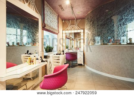 Interior Of New Modern Beauty Salon. Professional Mirrors And Chairs At Empty Hairdressers Studio