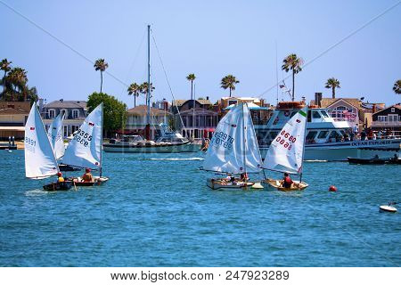 July 2, 2018 In Newport Beach, Ca:  People Sailing In Small Sail Boats Called Dinghy Boats Taken At