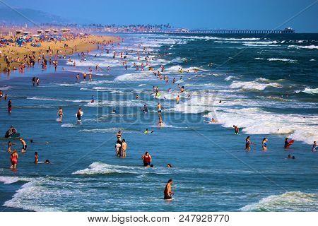 July 2, 2018 In Huntington Beach, Ca:  Crowds Of People On A Popular Sandy Beach Taken In Huntington