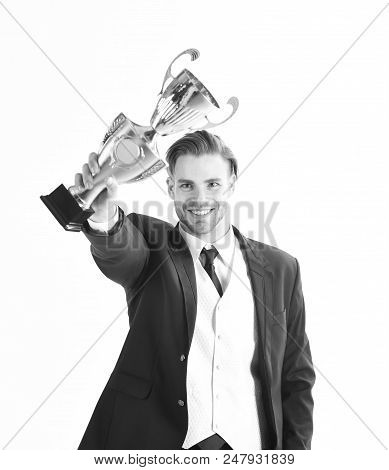 Businessman Celebrates Successful Start Up. Winner Holds Trophy And Smiles. Guy With Happy Face Show