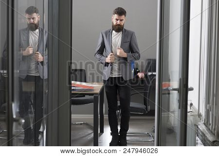 Business And Office Lifestyle. Bearded Man Look Out Room Door. Businessman In Modern Office With Gla