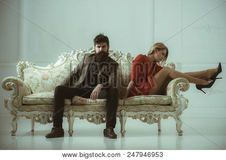 Relationship. Relationship Of Man And Woman Sit Alone On One Sofa. Bad Relatioship Of Cfamily Couple