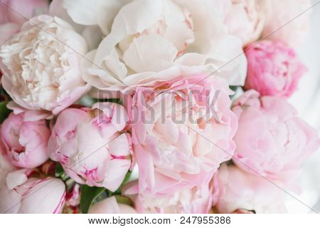 Floristry Concept. Bouquet Of Beautiful Flowers On Gray Table. Spring Colors. The Work Of The Floris