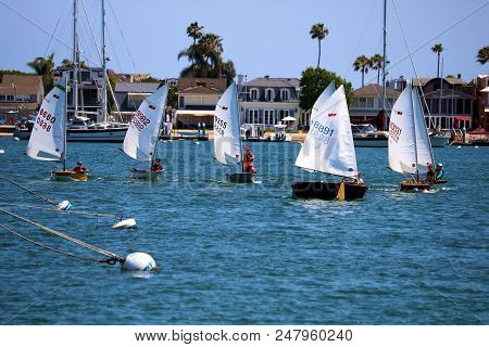 July 2, 2018 In Newport Beach, Ca:  People Sailing On Small Sail Boats Called The Dinghy Boats Taken