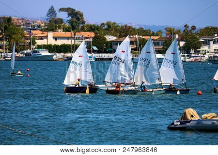 July 2, 2018 In Newport Beach, Ca:  People Sailing On Rental Dinghy Boats Which Are Small Sail Boats
