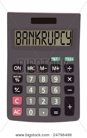 bankrupcy on display of an old calculator on white background poster