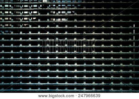 Metal Mesh. Wall Of Metal Grid. Metal Structure Of The Bars And Mesh. Dark Worn Rusty Metal Grid Tex