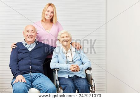 Family with senior couple and caring daughter at home care