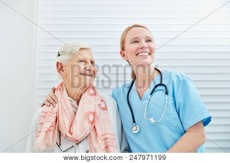 Smiling nursing woman with happy senior citizen