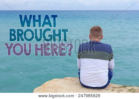 Writing note showing  What Brought You Here Question. Business photo showcasing Ambition can be obtain by determination Man sitting sand watching beach Message Relax reflection intention poster