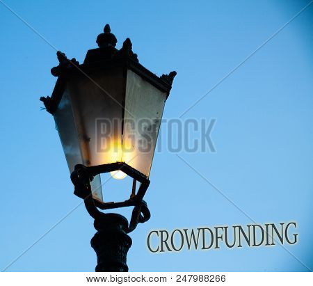 Conceptual Hand Writing Showing Crowdfunding. Business Photo Text Funding A Project By Raising Money