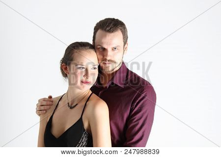 Portrait: Man In Suit And Woman In Dress On White Background. The Bride And Groom In An Isolated Pho
