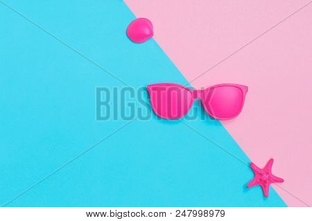 Pink Glasses And Seashells On Colorful Background. Minimal Concept. Creative Concept. Hot Summer Vib